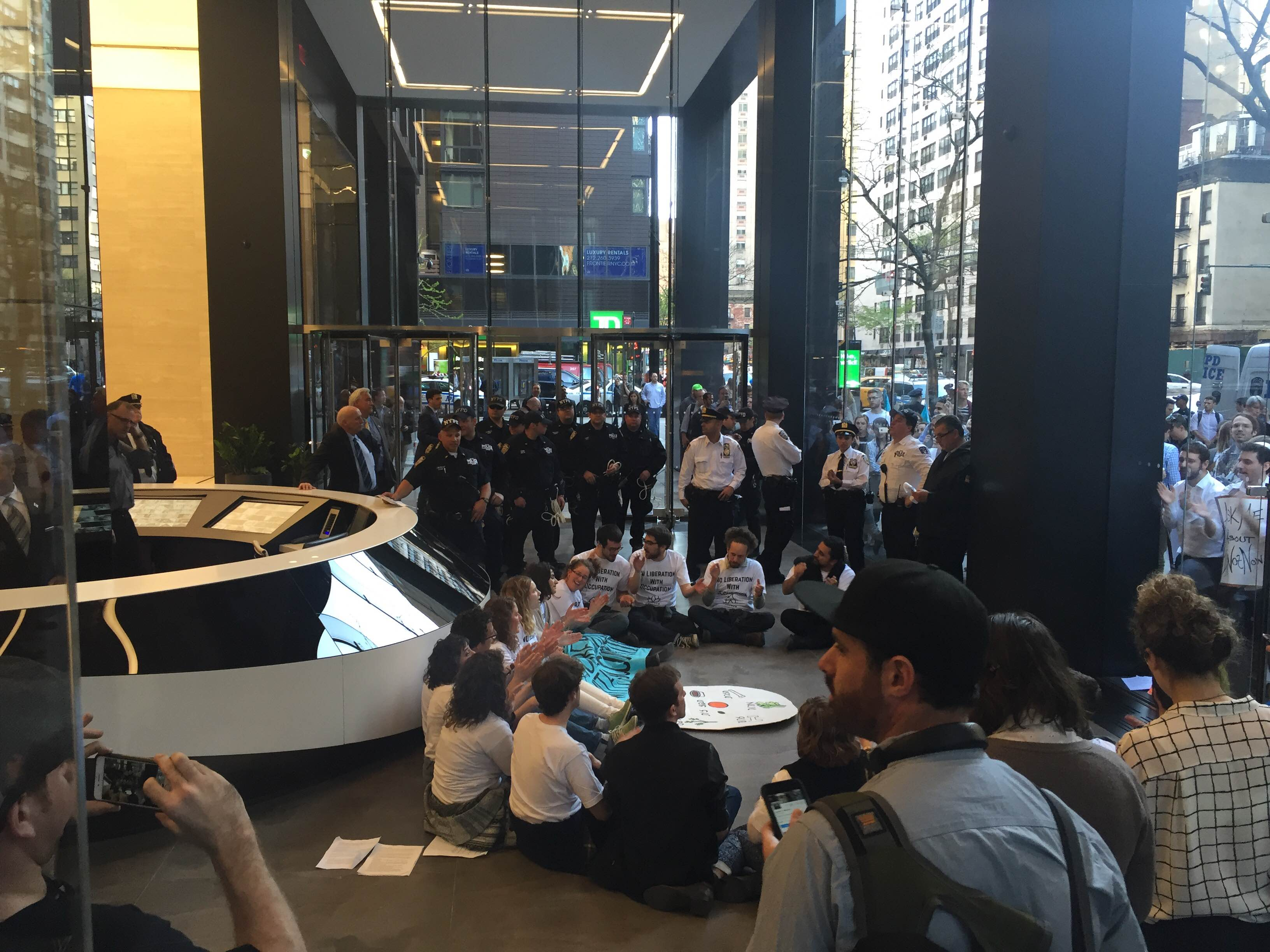 NYPD look on as activists occupy the lobby of the ADL. (Photo: Zac Rudge)