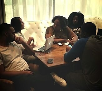"""SULC NLG at a scripting meeting for their """"Know Your Rights"""" video."""