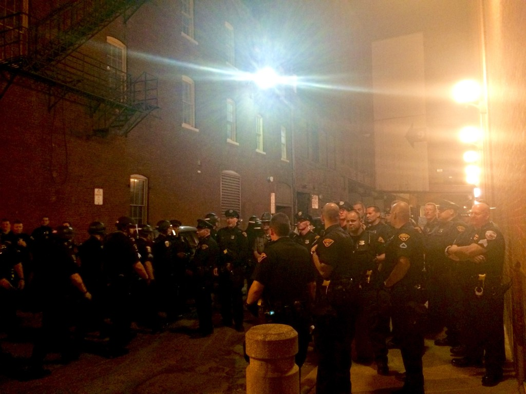 Cops block an alley to kettle protesters in Cleveland.