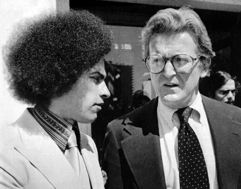 Michael Kennedy (right) with client Huey Newton (left) outside the Alameda County Court House, 1978. (Photo: United Press International)