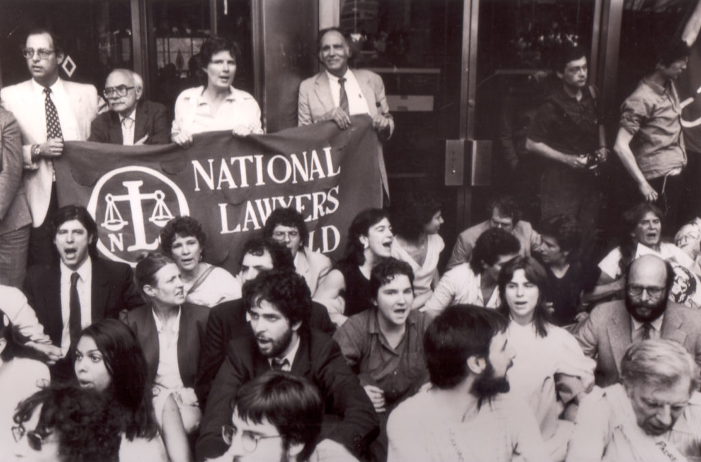 Michael Ratner (second row, far right) protests U.S. aid to the Contras in Nicaragua at a sit-in organized by the NLG-NYC Chapter in front of 26 Federal Plaza in Downtown Manhattan, 1984 (Photo: John Snow).