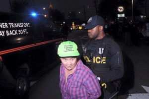 Amy Mei Willis is arrested while Legal Observing in Atlanta, GA. (Photo: Megan Harrison)